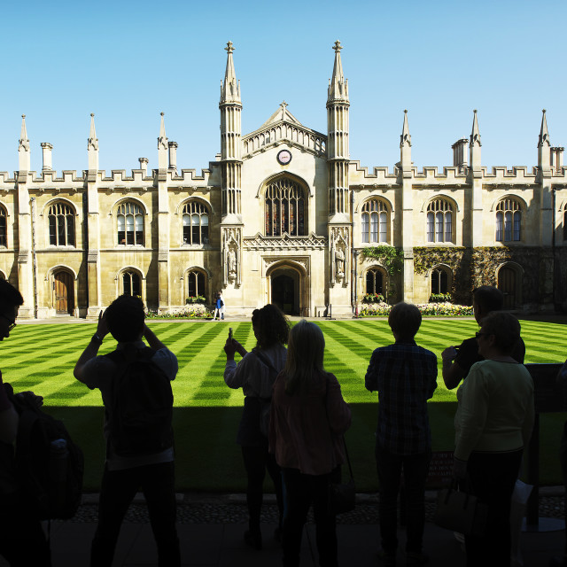 """Tourist in silhouette at corpus Christi college, Cambridge"" stock image"