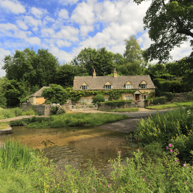 """The river Eye at Upper Slaughter village, Gloucestershire Cotswolds, England, UK"" stock image"