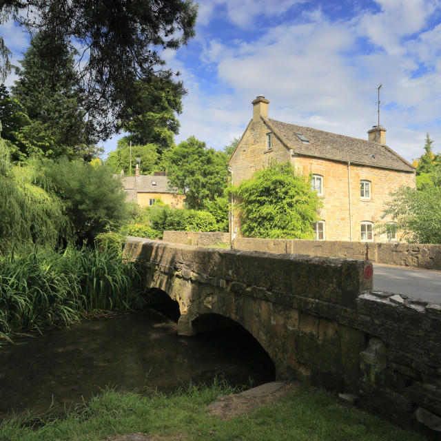 """The Stone built Cottages of Naunton village, nestling in the river Windrush..."" stock image"