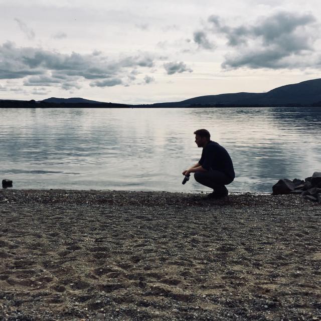 """Dog walking at Loch Lomond"" stock image"