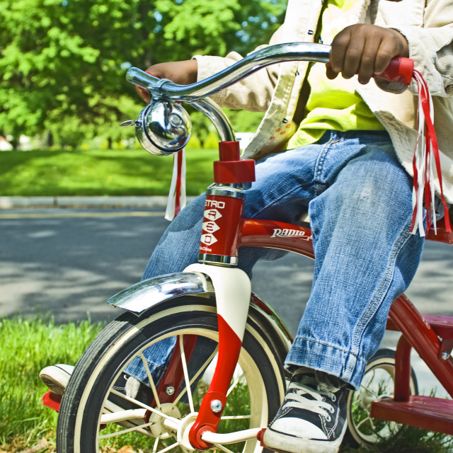 """Boy Riding Tricycle"" stock image"