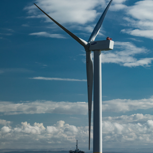 """Wind Turbine and Oil Rig"" stock image"