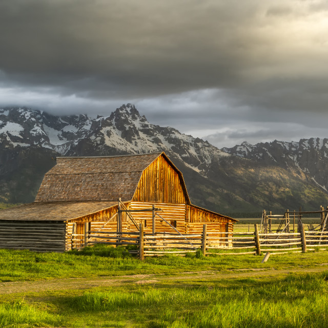 """Storm Clouds over The Mormon Barn in Grand Teton National Park"" stock image"