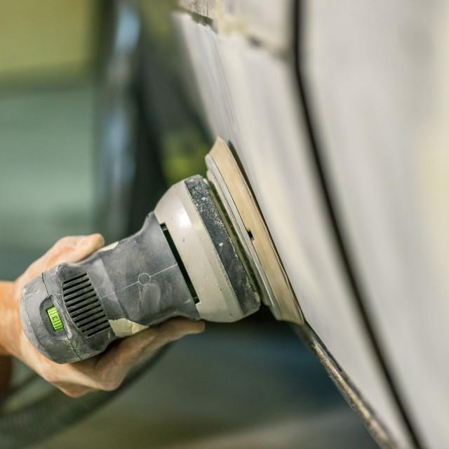 """Bulgarian mechanic working in auto shop."" stock image"