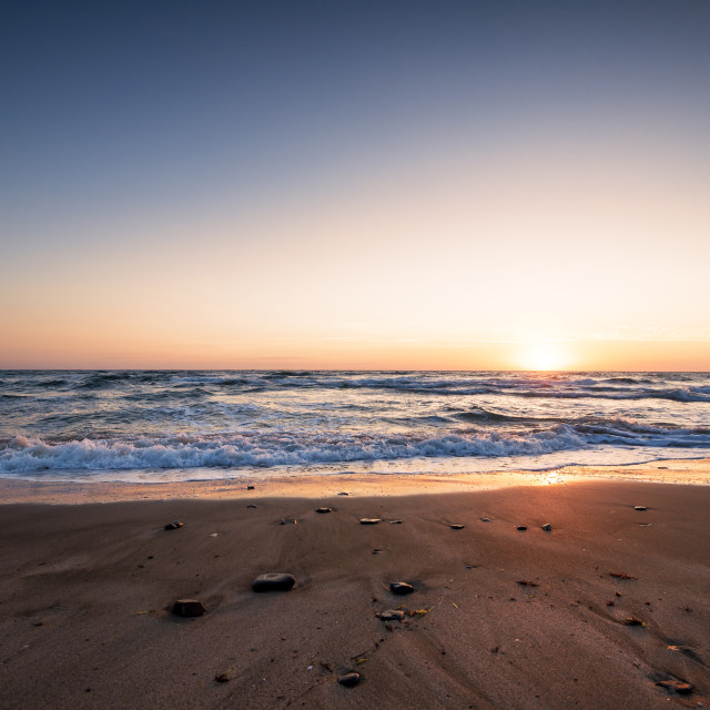 """Sunrise at the beach."" stock image"
