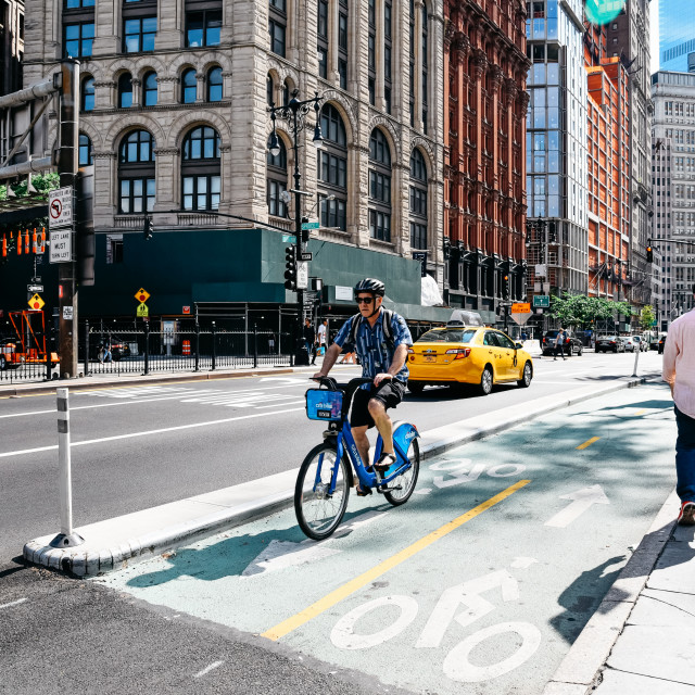 """""""Cyclist riding on bike lane in New York"""" stock image"""
