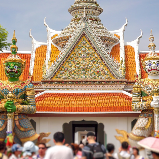"""""""Twin Giants Stand Guard at Entrance to Wat Arun in Bangkok, Thailand"""" stock image"""