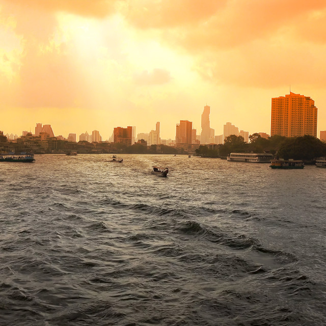 """Bangkok Skyline and Boats on Chao Phraya River at Sunrise in Thailand"" stock image"