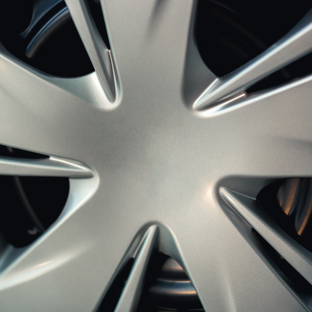 """Close up image of silver alloy tires wheels in car vehicle."" stock image"