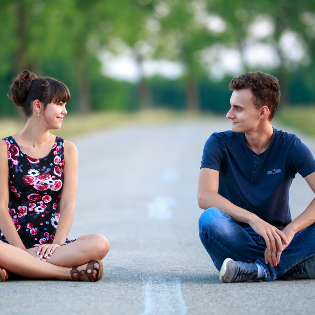 """Couple sitting in the middle of the road"" stock image"