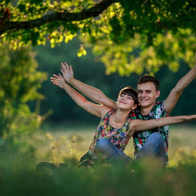 """Happy couple at sunset"" stock image"