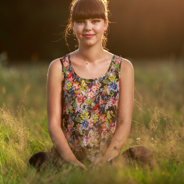 """Young girl outdoor at sunset"" stock image"
