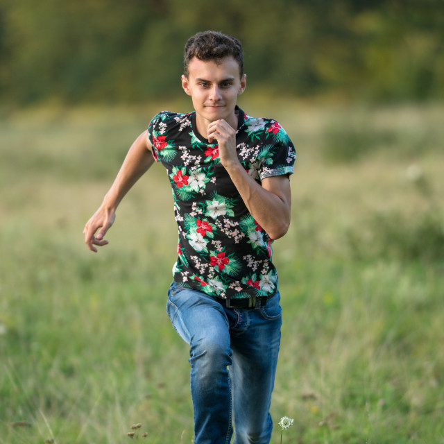 """Young boy running"" stock image"