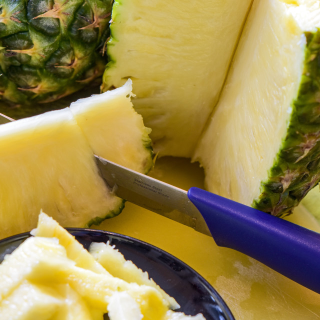 """""""Macro shot of a ripe and sliced pineapple fruit (Ananas comosus)."""" stock image"""