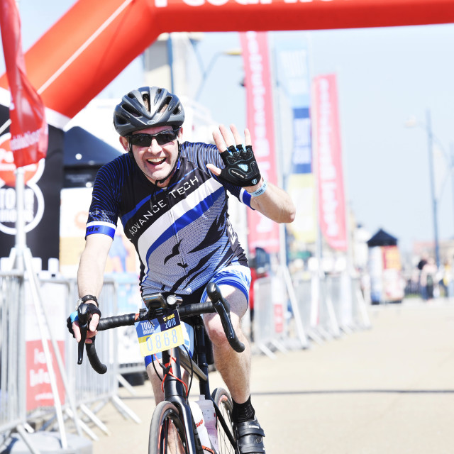 """middle aged man in lycra celebrates completing a cycle event"" stock image"