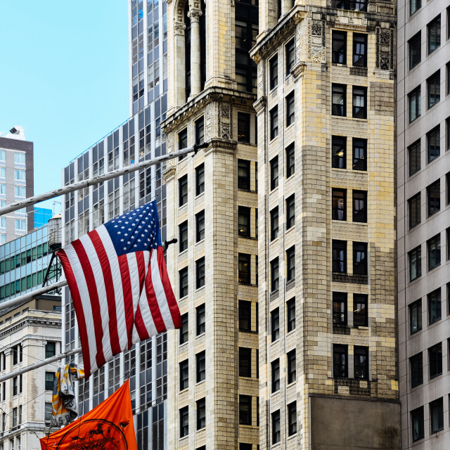 """""""Low angle view of american flag against skyscrapers in New York"""" stock image"""