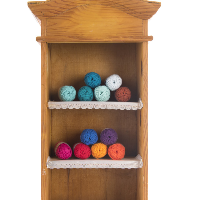 """Vintage wooden cabinet with knitting wool"" stock image"