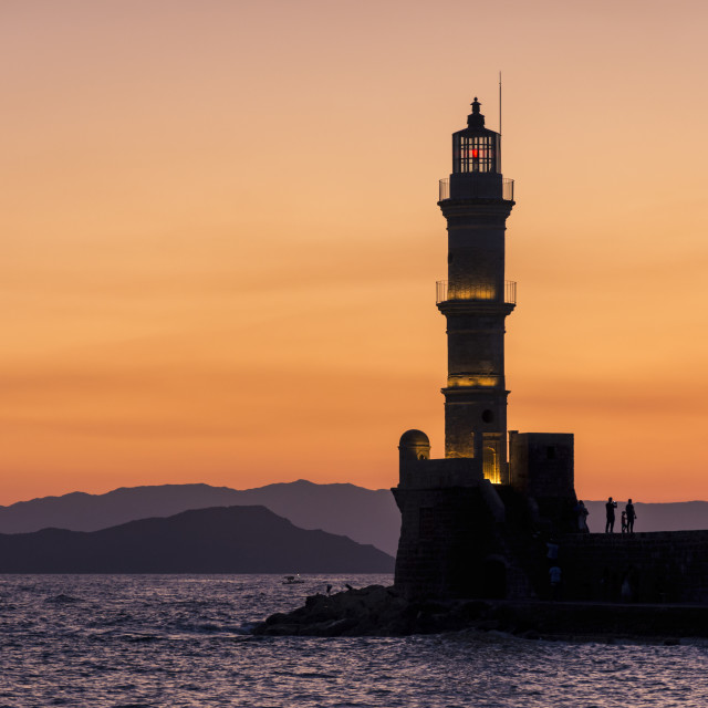 """Chania lighthouse sunset silhouette"" stock image"