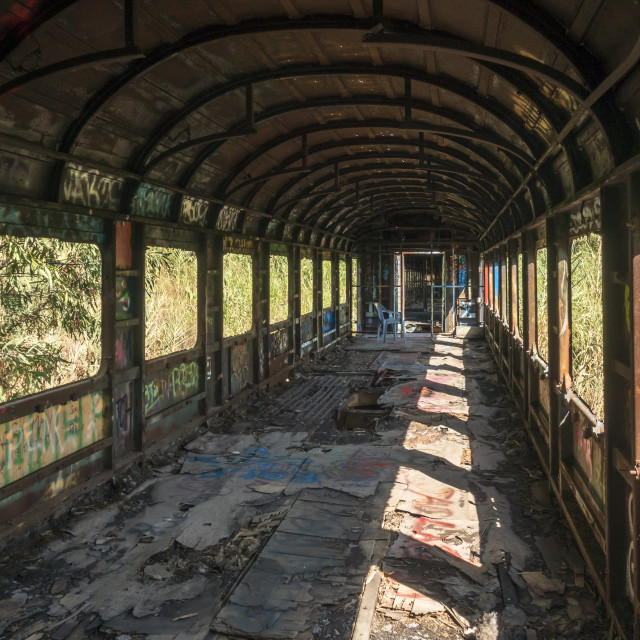 """""""Interior of abandoned wreck of an old train wagon, Spain."""" stock image"""