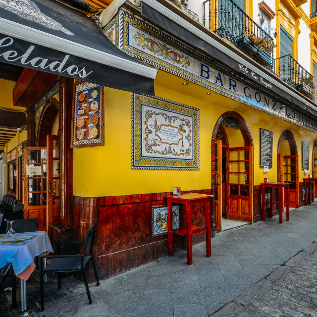 """Facade of traditional colourful tapas bar in the historic centre of Seville"" stock image"
