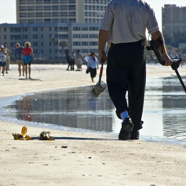 """Man Treasure Hunting On Beach"" stock image"