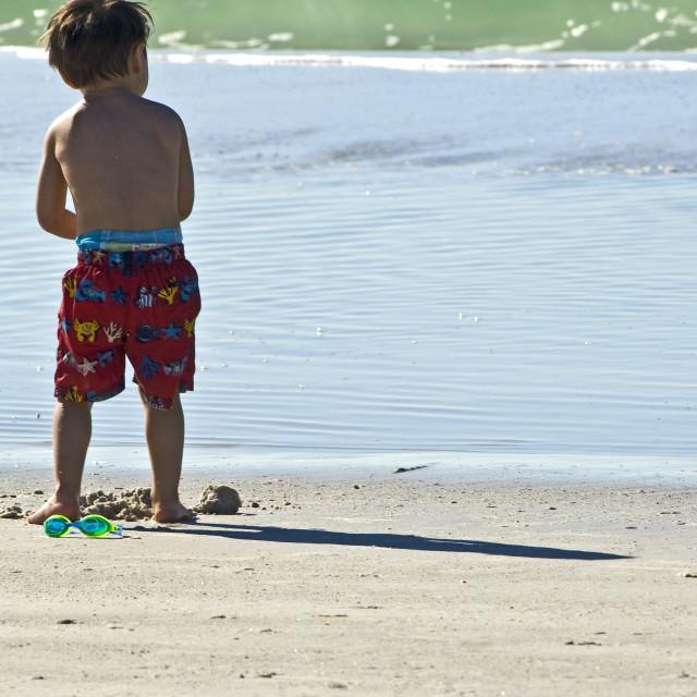 """Boy At Edge Of Seashore"" stock image"