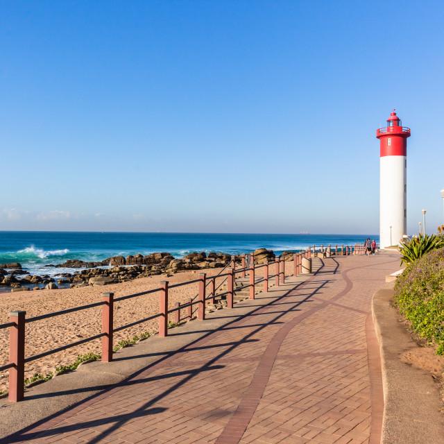 """Beach Ocean Lighthouse Promenade"" stock image"