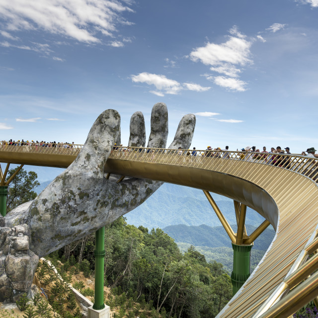 """""""The panoramic view of Golden Bridge is lifted by two giant hands in the tourist resort on Ba Na Hill in Danang, Vietnam."""" stock image"""