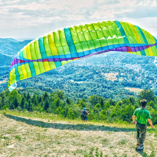 """""""Paragliding from Merkur Mountain"""" stock image"""