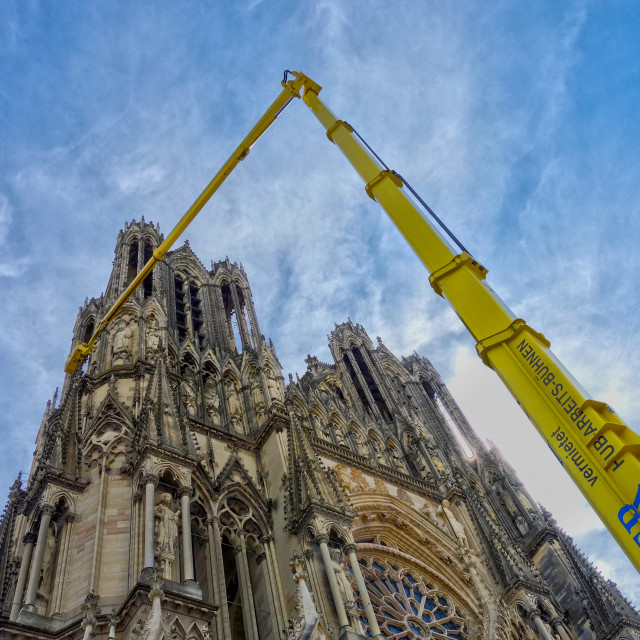 """""""Cleaning up Reims Cathedral"""" stock image"""