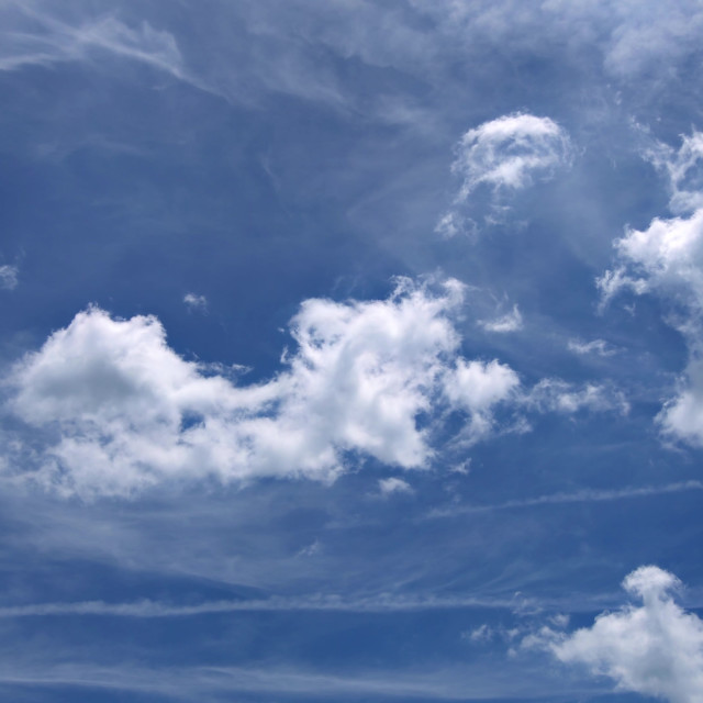 """Puffy white clouds blue sky beautiful day 4K video resolution"" stock image"