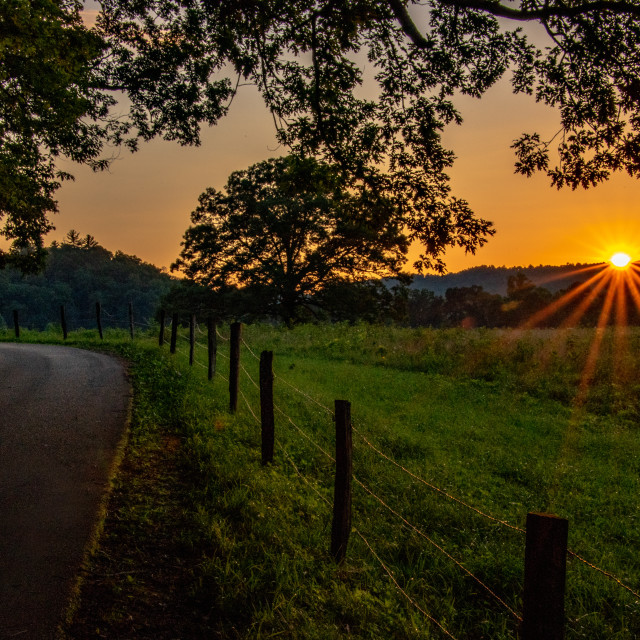 """Sunburst over Cades Cove"" stock image"
