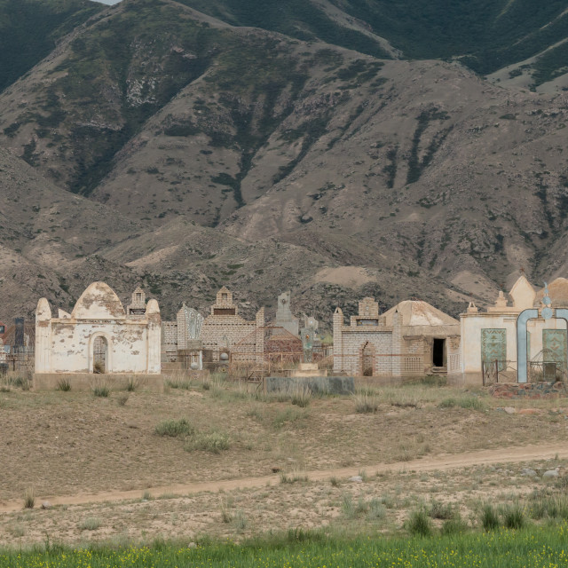 """Old Soviet era cemetery with rusting tombs in the alpine desert near Bokonbayevo, Kyrgyzstan"" stock image"