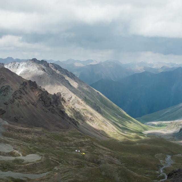 """High altitude mountain landscape, on the popular hike from Altyn Arashan to Lake Alakol, near Karakol, Kyrgyzstan"" stock image"