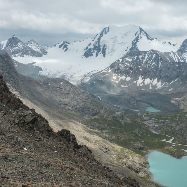 """""""Glaciers and snow capped mountains near Lake Alakol, Kyrgyzstan"""" stock image"""