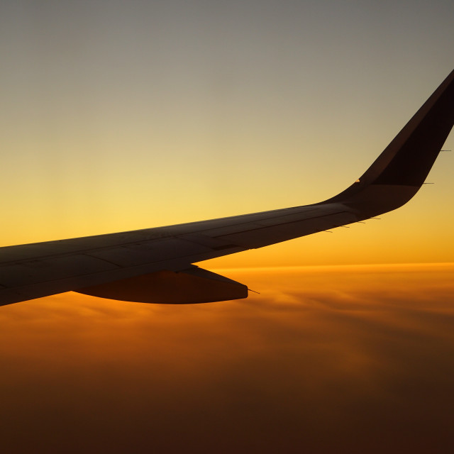 """Watch Sunset from the plane"" stock image"