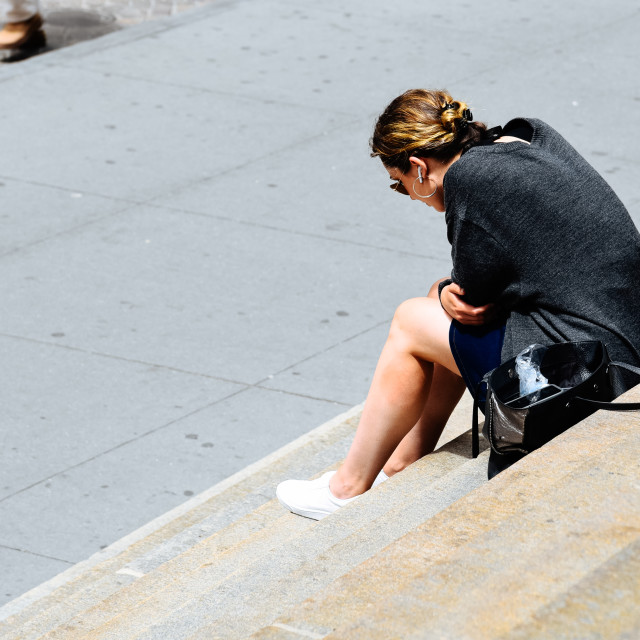 """""""Woman with headsets sitting on steps in New York"""" stock image"""