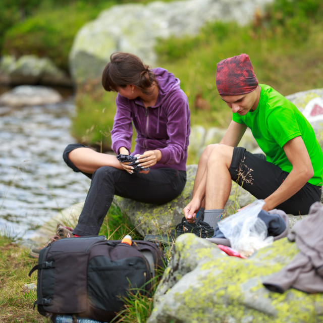 """""""Young hikers by the lake"""" stock image"""