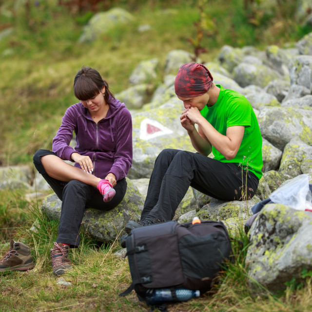 """""""Couple of hikers resting"""" stock image"""