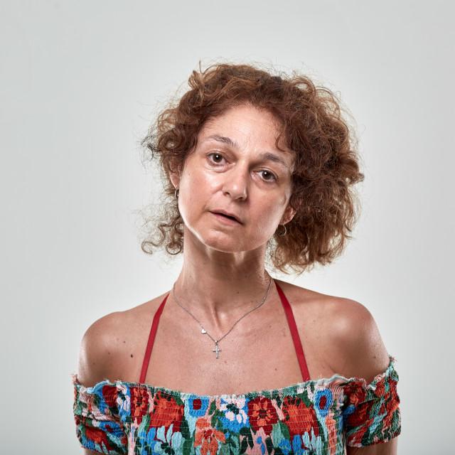 """Sad woman on gray background"" stock image"