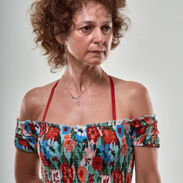 """""""Mature lady with an expresion of doubt"""" stock image"""