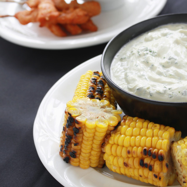 """barbecue sweetcorn with tzatziki dip"" stock image"