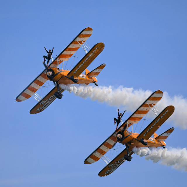 """""""Aerosuperbatics Wingwalkers put on a show on the last day of the Eastbourne International Air Show"""" stock image"""