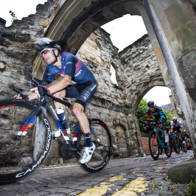 """Pro bike race on the cobbles"" stock image"
