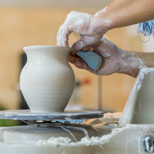 """Creating a jar or vase of white clay close-up. Master crock. Man hands making..."" stock image"