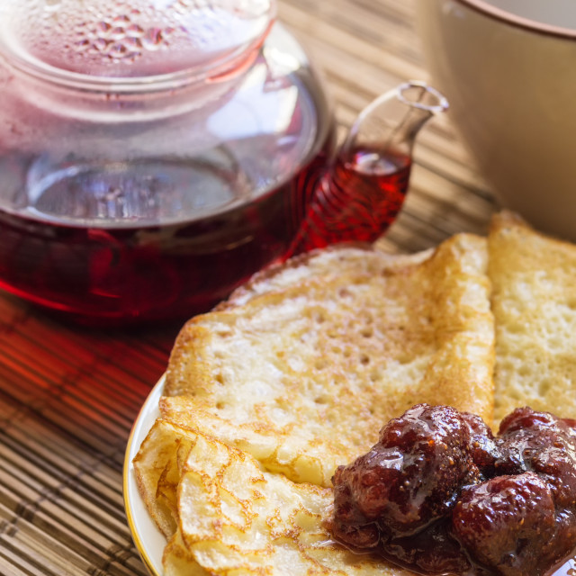 """""""Teapot, a cup, and pancakes on a plate ."""" stock image"""
