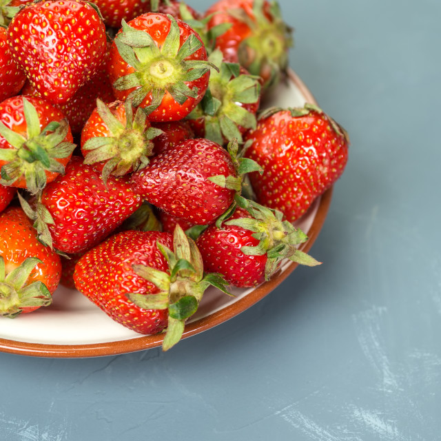 """""""Plate with strawberries on a light-blue background"""" stock image"""