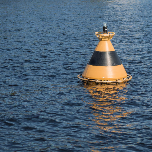 """""""Yellow-black buoy in the water"""" stock image"""