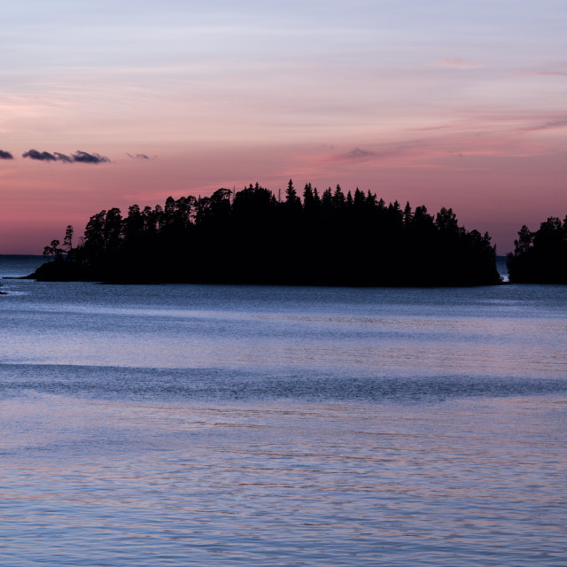 """""""Sunset at the sea. the horizon with dark silhouettes is island."""" stock image"""