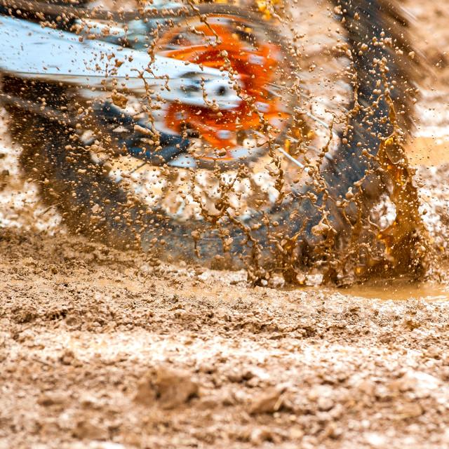 """Motocross bike wheel in mud"" stock image"